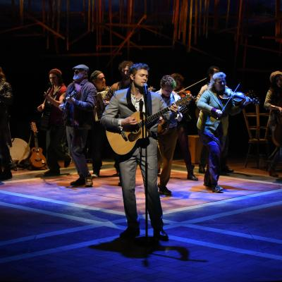 A production photo of the cast on stage
