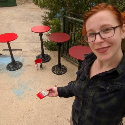 Painting the tables red for the set of Cabaret