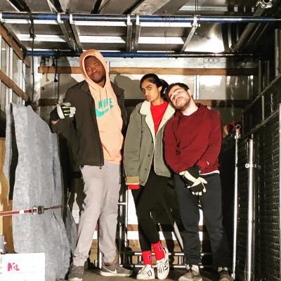 CJ, Saira, and John packing the truck
