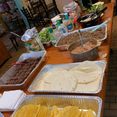 Ground beef, shredded roti chicken, vegetarian refried beans, lettuce and other toppings, brownies, and salad