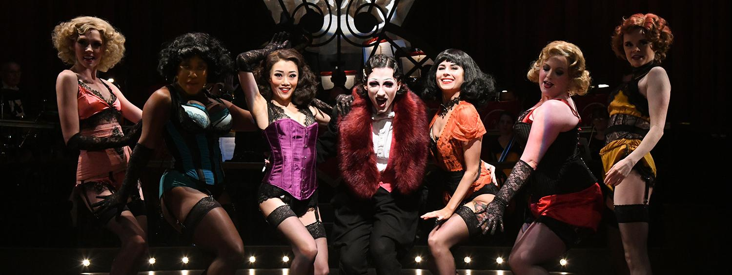 Mason Alexander Park (center) as the Emcee and the Kit Kat Girls in CABARET at Olney Theatre Center.