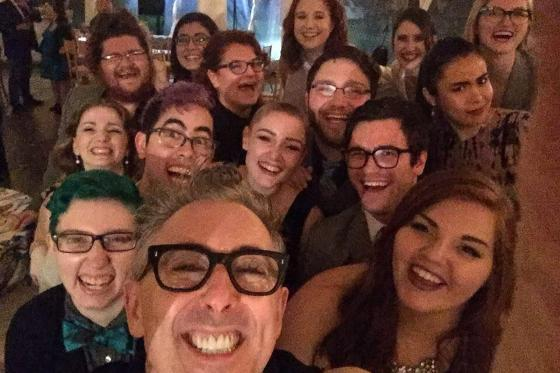 A group selfie with Alan Cumming and the apprentices